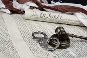 Constitution, Gavel and handcuffs