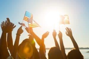 Crowd of waving American flags.