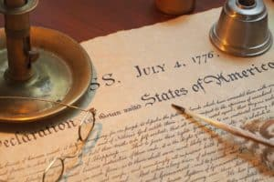 Declaration of Independence with candle holder, glasses and quil