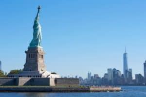 Statue of Liberty island and New York city skyline in a sunny da